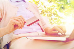 Senior woman with laptop and credit card Stock Images