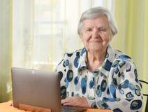 Senior woman with laptop. Royalty Free Stock Photos