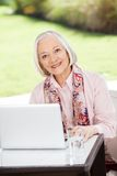 Senior Woman With Laptop At Nursing Home Porch Royalty Free Stock Images