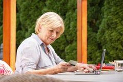 Senior woman with laptop Royalty Free Stock Image