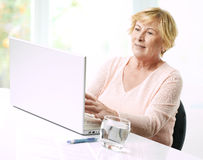 Senior woman with laptop. Royalty Free Stock Photo