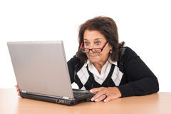 Senior woman with laptop Stock Photos