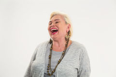 Senior woman laughing isolated. Royalty Free Stock Images