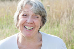 Senior woman laughing out loud Stock Photos