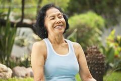 Senior woman laught at park stock image