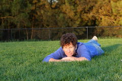Senior woman laying on the grass. Smiling senior woman laying in the grass Stock Photos