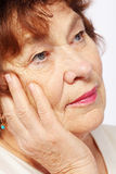 Senior woman leaned head on hand Stock Photo