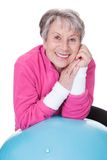 Senior woman leaning on pilates ball Royalty Free Stock Photos