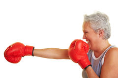 Senior woman learning how to fight Stock Photo