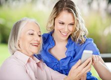 Senior Woman Learning Mobile Phone Stock Images