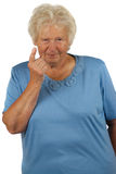 Senior woman with lifted forefinger Stock Images