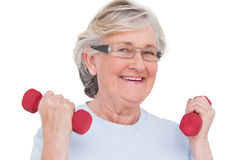 Senior woman lifting hand weights Royalty Free Stock Photos