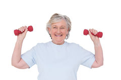 Senior woman lifting hand weights Royalty Free Stock Photography