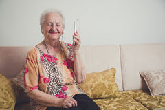 Senior woman listening music Stock Image