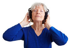 Senior woman listening to music Royalty Free Stock Photography