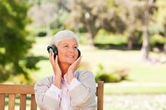 Senior woman listening to some music Royalty Free Stock Photos