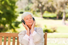 Senior woman listening to some music Royalty Free Stock Images