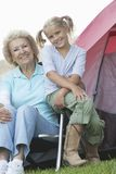 Senior Woman With Little Girl Outside Tent Royalty Free Stock Photo