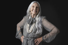 Senior Woman With Long Gray Hair Smiling Stock Images