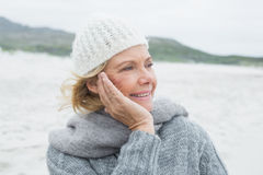 Senior woman looking away at beach Stock Images