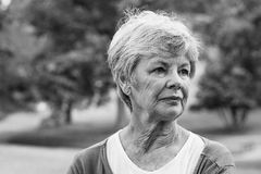 Senior woman looking away at park Royalty Free Stock Photo