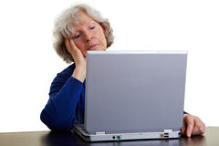 Senior woman looking bored at Royalty Free Stock Photography