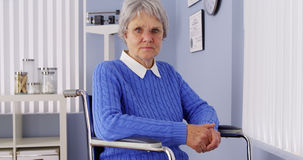 Senior woman looking at camera in wheelchair Royalty Free Stock Photo