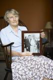 Senior Woman Looking At Old Wedding Photo Stock Photography