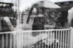 Senior woman looking out through a window like depress Stock Photos