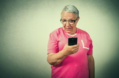 Senior woman looking on phone Royalty Free Stock Image