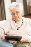 Senior Woman Looking At Photograph Stock Image