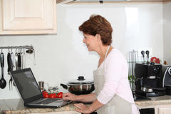 Senior woman looking for recipe Stock Photos
