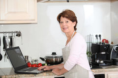 Senior woman looking for recipe Royalty Free Stock Photo