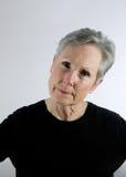 Senior woman looking serious, skeptical Stock Photos