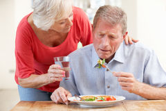 Senior woman looking after sick husband Stock Photography