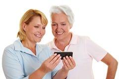 Senior woman looking at smartphone stock photos