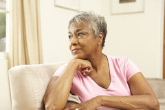 Senior Woman Looking Thoughtful In Chair Royalty Free Stock Photos