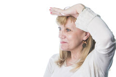 Senior woman looking to the distance. Middle aged caucasian woman having trouble seeing long distance Royalty Free Stock Image