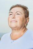 Senior woman looking up Stock Photos
