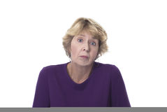 Senior woman looking upset. Senior woman with an expression of despair or confusion on a white background Stock Image
