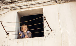 Senior woman looking through window in Bari Royalty Free Stock Photos