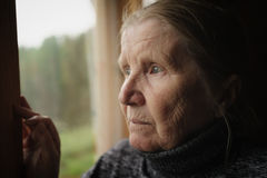 Senior woman looking in a window Royalty Free Stock Photography