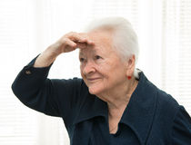 Senior woman looks off into the distance Royalty Free Stock Images