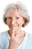 Senior woman with lotion blob on Stock Photo