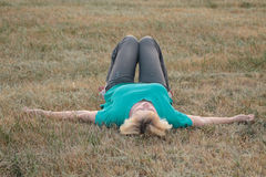 Senior woman lying on back outside Royalty Free Stock Images