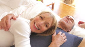 Senior woman lying on husbands  Stock Photo