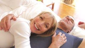 Senior woman lying on husbands  stock footage