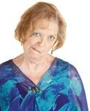 Senior Woman Makes Strange Faces Stock Image
