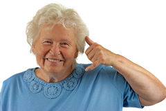 Senior woman is making a call me gesture Royalty Free Stock Photo