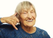 Senior woman is making a call me gesture Stock Photography